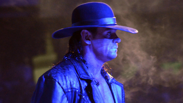 the undertaker gives respect to braun strowman roman reigns