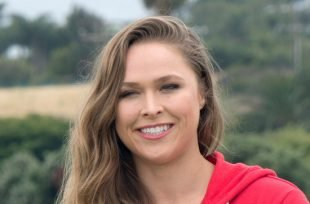 Wrestlezone image Ronda Rousey Signs Her WWE Contract, Puts Triple H Through A Table (Photos / Video)