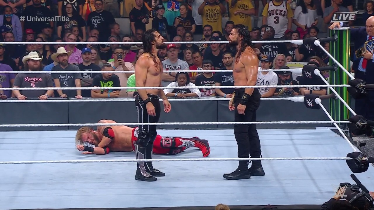 Seth Rollins Helps Roman Reigns Beat Edge And Retain Wwe Universal Title At Wwe Money In The Bank